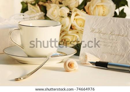 Taking a break for tea and writing wedding invitation - stock photo