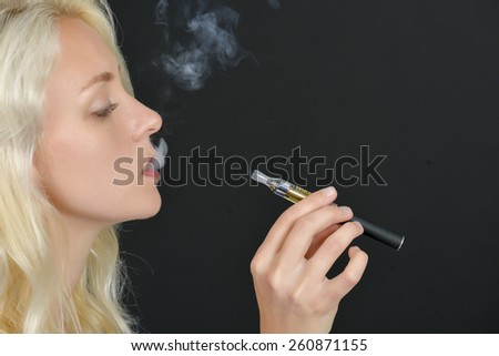 Taking a drag off an electric cigarette - stock photo