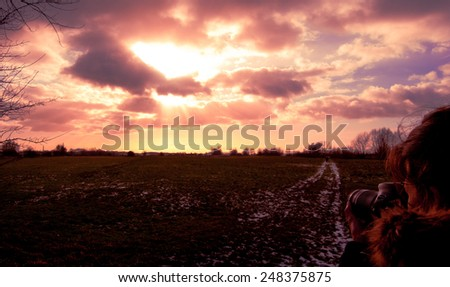 taking a photo of the sunset - stock photo