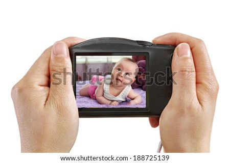 Taking a Picture of a Baby isolated on white - stock photo