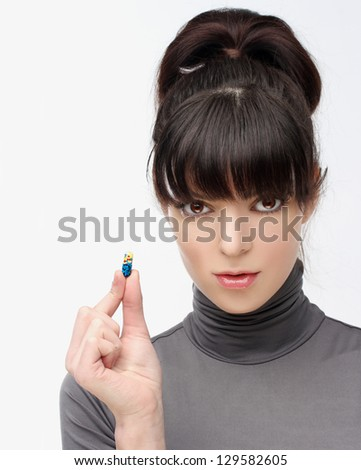 Taking a pill - stock photo