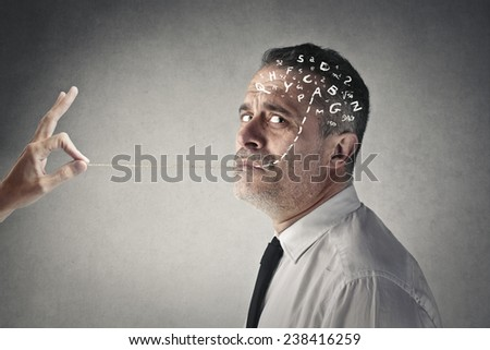Taking a rope out of his mouth  - stock photo