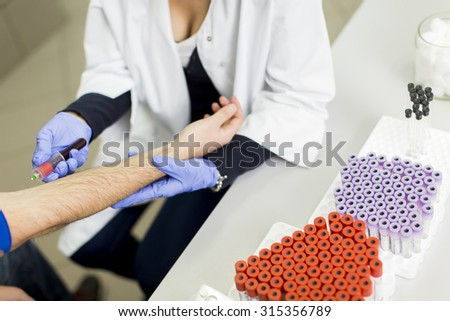 Taking blood in laboratory - stock photo