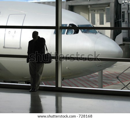 Taking care of last minute business before departure - stock photo