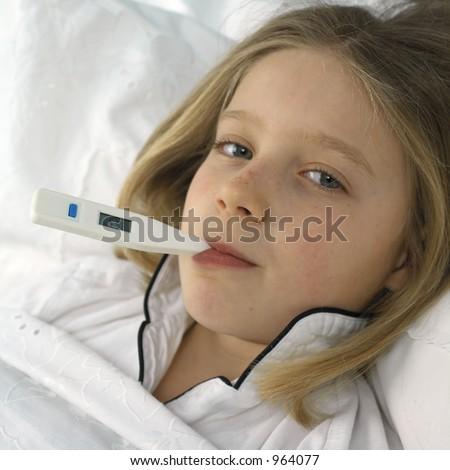 taking her temperature - stock photo