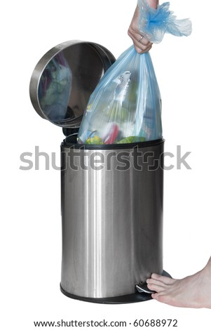 Taking litter away from the steel bin - stock photo
