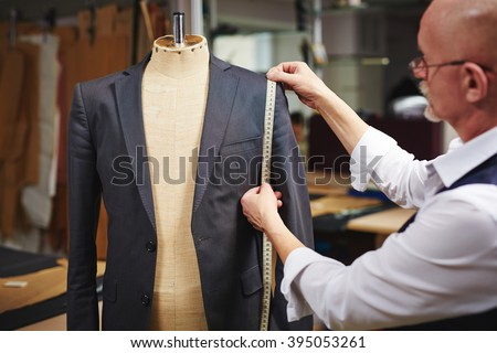 Taking measures from jacket - stock photo