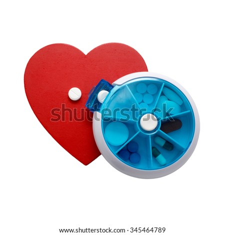 taking medication for heart disease. red heart and pillbox with pills isolated on white background - stock photo