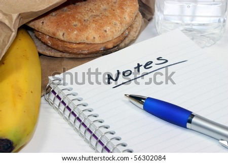 Taking notes during brown bag lunch meeting - stock photo