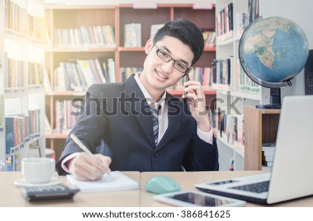 taking notes from a telephone conversation with customers. - stock photo