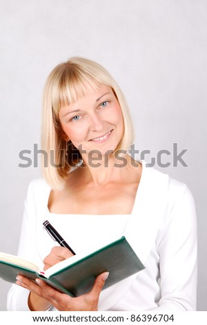 Taking notes/Young Woman taking notes