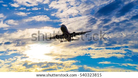 taking off or landing plan in the morning or evening cloudy blue sky