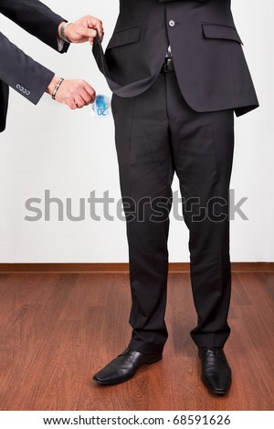 Taking Out The Money From The Pocket - stock photo