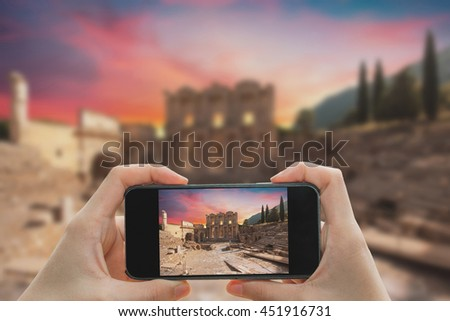 Taking photo on smart phone concept.Celsus Library in Ephesus, Turkey - stock photo