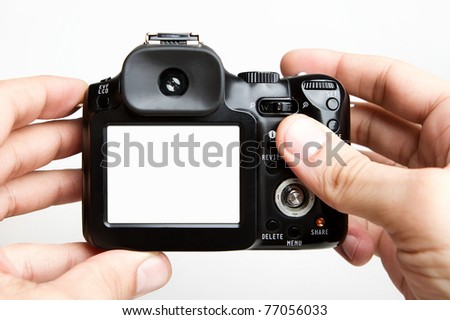 Taking photo with compact camera - stock photo