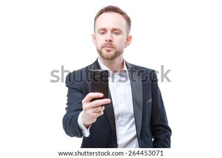 Taking photo with smartpnone. Confident young businessman in suit using mobile phone. Isolated on white. - stock photo