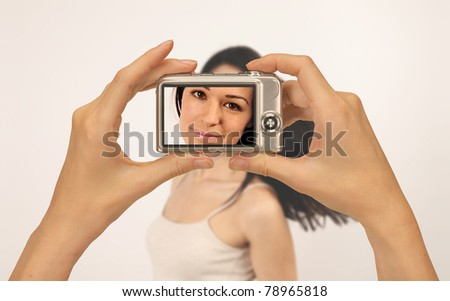 taking photograph of a beautiful girl with a compact digital camera - stock photo