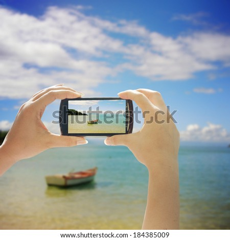 Taking pictures with smart phone - stock photo