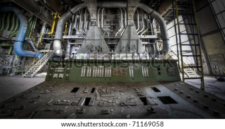 Taking place behind the operating panel at an abandoned factory. The great view the operator could see before the crisis hit them hard. - stock photo