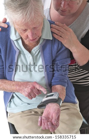 Taking the blood pressure of an elderly person - stock photo