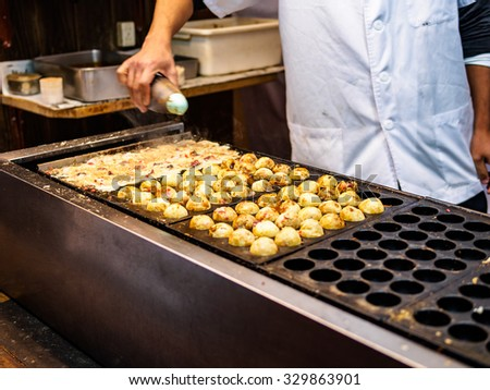 Takoyaki shop in Osaka, Japan, Employees are doing Takoyaki shop.