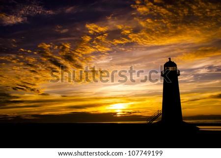 Talacre Lighthouse against a dramatic sunset - stock photo