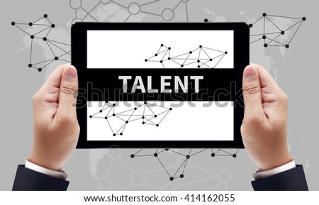 TALENT CONCEPT on the tablet pc screen by businessman hands, top view - stock photo