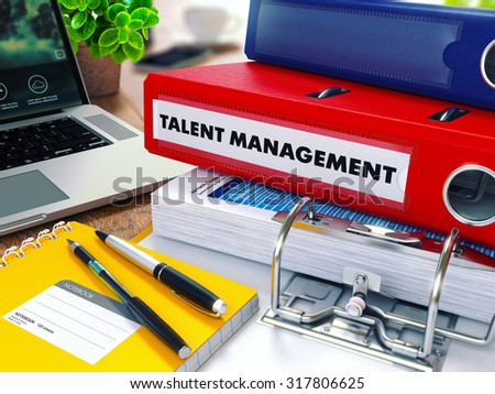 Talent Management - Red Ring Binder on Office Desktop with Office Supplies and Modern Laptop. Business Concept on Blurred Background. Toned Illustration. - stock photo