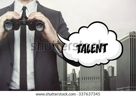 Talent text on speech bubble with businessman holding binoculars on city background - stock photo