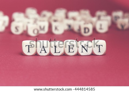 Talent word written on wood cube with red background