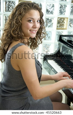 Talented and beautiful piano player shallow depth of field