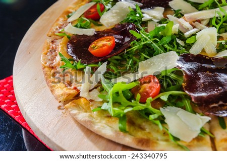 talian pizza topped with hammon and cheese. - stock photo