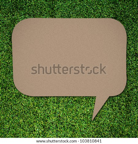 talk quote on Green grass background - stock photo