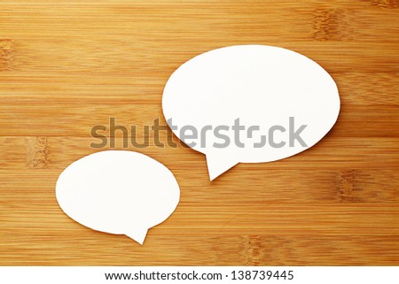 talk speech bubble on wood background - stock photo