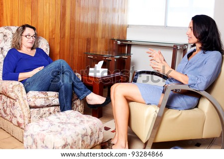 Talking to a doctor during psychoanalysis - stock photo