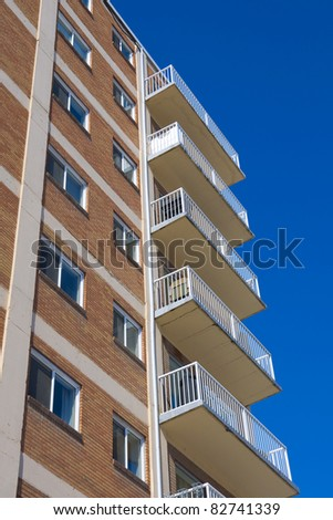 Tall apartment building in Calagary. Alberta, Canada. Residential architecture - stock photo
