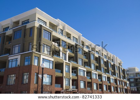 Tall apartment building in Calgary. Alberta, Canada. Residential architecture - stock photo