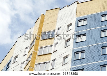 tall apartments building against sky and clouds - stock photo
