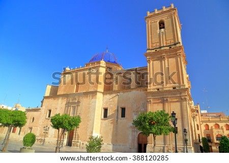 Tall belfry and building of Santa Maria Basilica in Elche, Alicante, Spain - stock photo