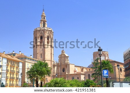 Tall belfry near the Metropolitan Cathedral - Basilica of the Assumption of Our Lady of Valencia (Saint Mary's  or Valencia Cathedral) in Valencia, Spain - stock photo