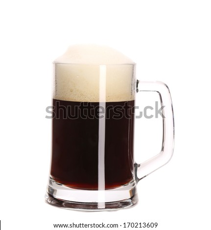 Tall big mug of brown beer with foam. Isolated on a white background.