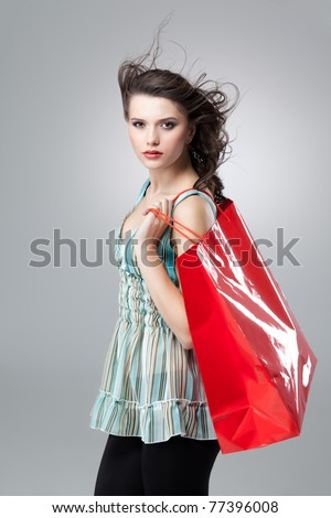 tall brunette woman shopping red bag arms