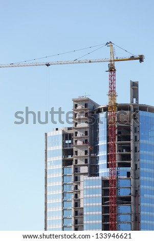 tall building under construction - stock photo