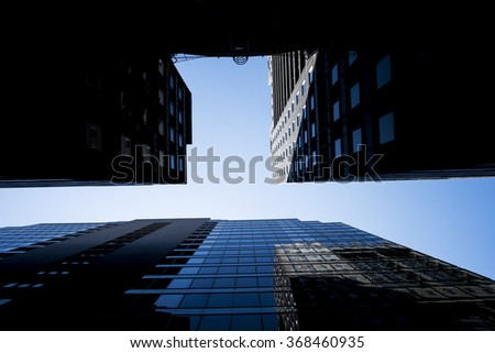 Tall Buildings Against Blue Sky - stock photo