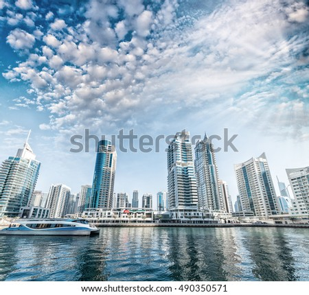 Tall buildings of Dubai at sunset, UAE.