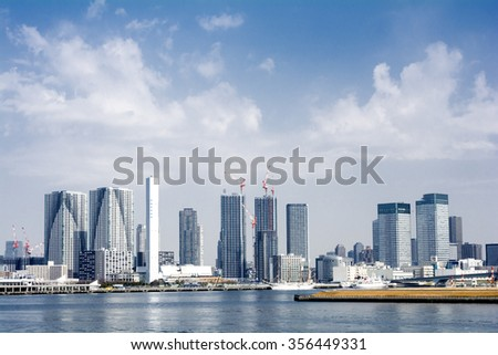 Tall buildings of Tokyo gulf area under sky