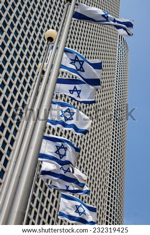 Tall buildings with israeli flags - stock photo