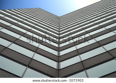 Tall business building with blue sky - stock photo