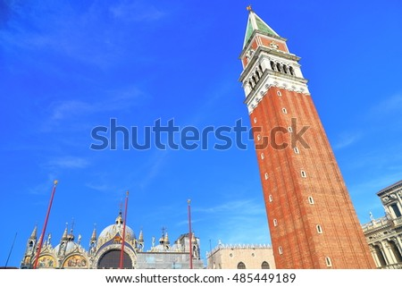 Tall Campanile (belfry) under the blue sky in Piazza San Marco, St Mark's Square, Venice, Italy