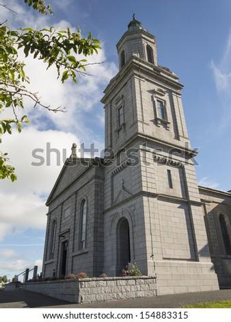 tall church tower on a modern Irish church - stock photo
